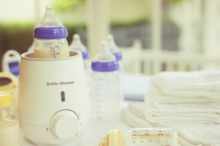 Bottle warmer and baby food warmer with Copy Space Stock Photo
