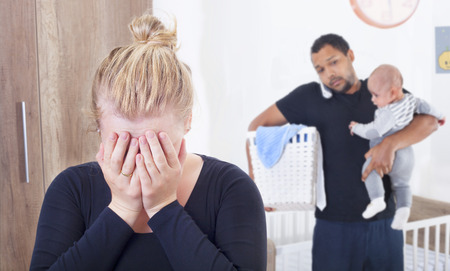 Young woman suffering from postpartum depression