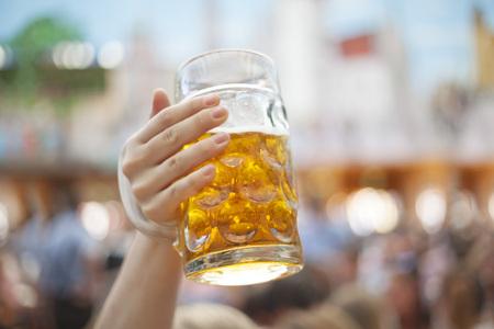 Raising beer steins at Oktoberfest