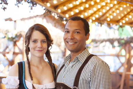 give out: Couple enjoying Oktoberfest