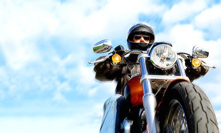 Biker On the road over sky