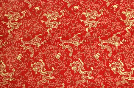 fabric design: Fragment of red chinese silk with golden dragons and flowers Stock Photo