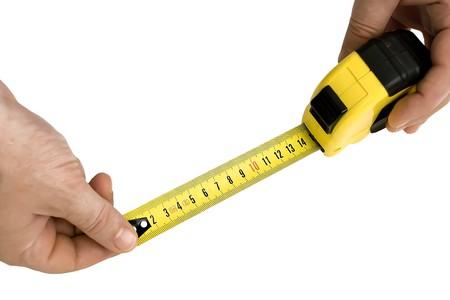 yardstick: mans hands holding a yardstick