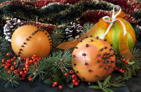 Christmas composition with oranges decorated with cloves