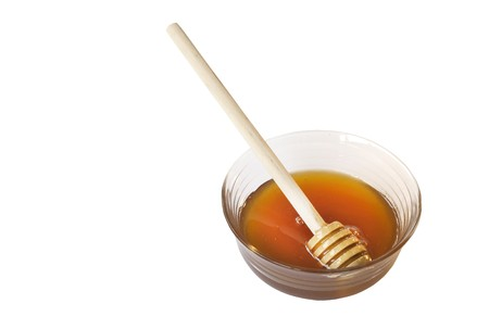 Glass bowl and wooden spoon with honey Stock Photo - 8230996