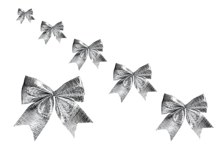 Silver christmas bows on the white background Stock Photo