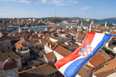 Aerial view from tower on croatian town Trogir and flag Stock Photo