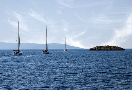 Small island in Adriatic sea and yachts Stock Photo
