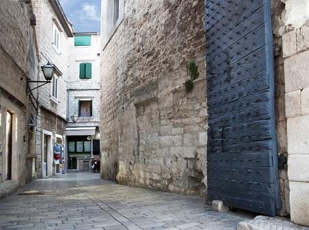 Old street with blue gate in Croatia_Split photo