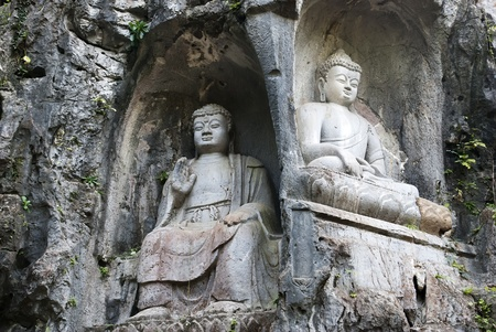 Sculptures  of  Buddha carved into the rock in Hangzhou Stock Photo