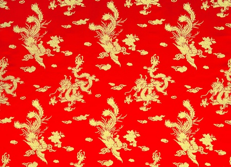 Background of chinese red silk with dragon and phoenix Stock Photo
