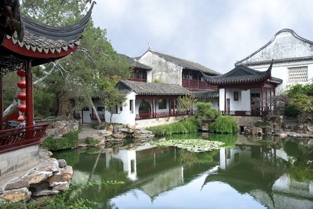 Chinese classical garden with pavilions and pond in Suzhou