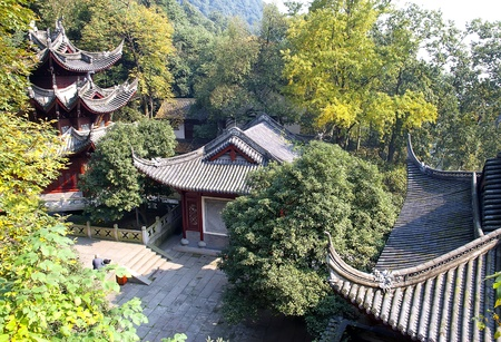 Tile roofs of mountain buddhist temple near Hangzhou in China