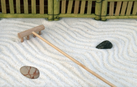 Traditional japanese zen garden with rake and rocks