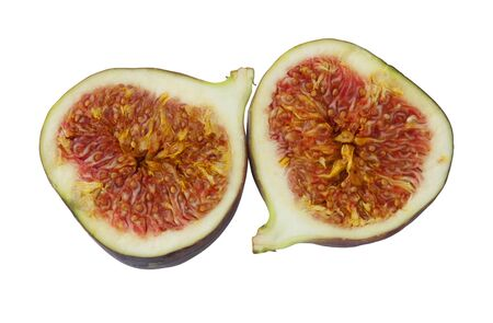 The two halves of the cut fig on white background