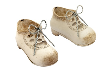 A pair of vintage boots souvenir on white background