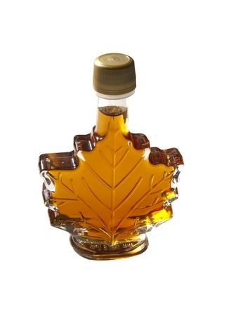 Figured bottle of maple syrup on white background