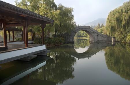 Chinese stone bridge on Xihu lake in Hangzhou