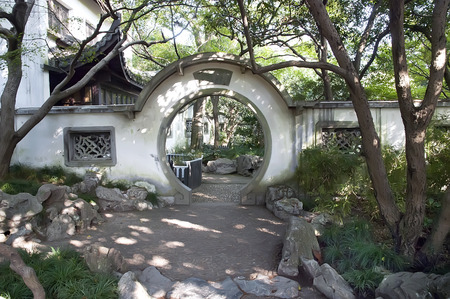 Traditional round gate and courtyard in chinese garden
