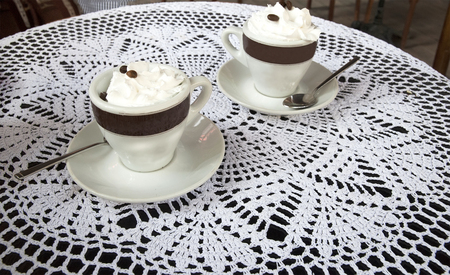 Two cups of coffee with whipped cream