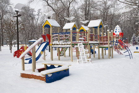 Winter children playground in the middle of city Stock Photo