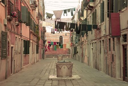 Clothes hanging on a rope on a traditional Venetian street Stock Photo