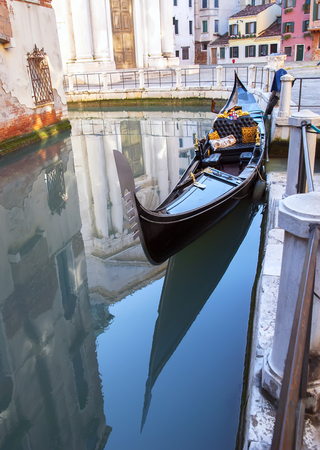 Traditional venetian gondola on the small canal water Stock Photo