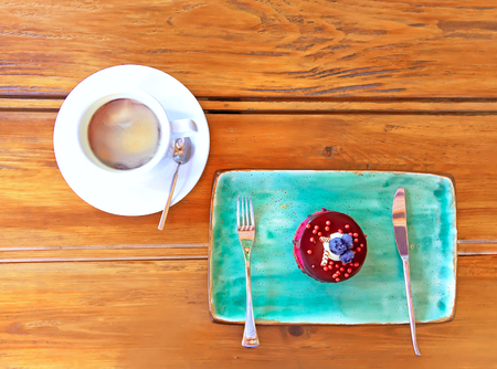 Blueberry cheesecake on plate and cup of coffee