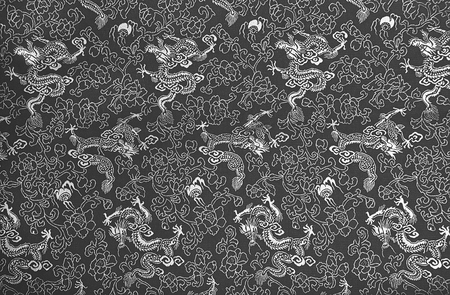 Fragment of grey chinese silk with dragons and flowers Stock Photo