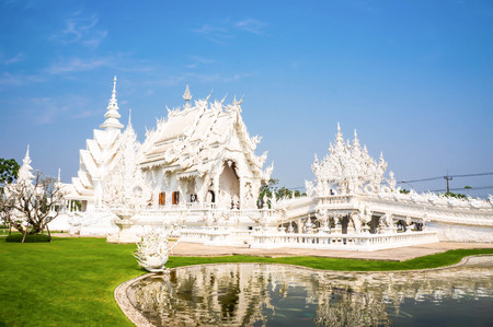 Famous white church in Wat Rong Khun, Chiang Rai province, Thailand. photo