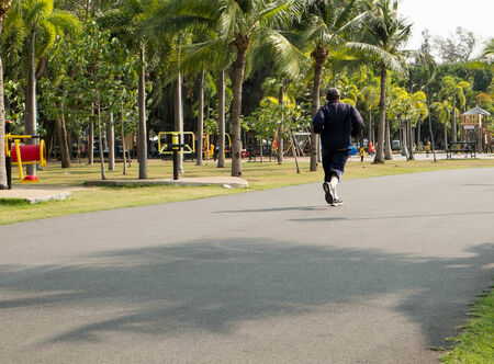 old man joging on park. photo