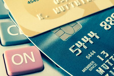 credit card on calculator vintage style photo