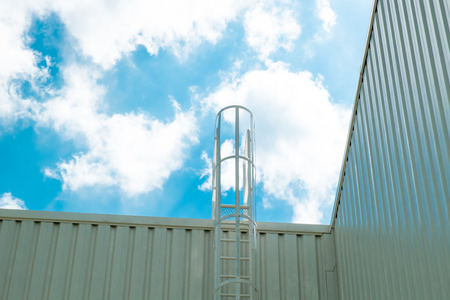 Safety Ladder of Factory with sky photo