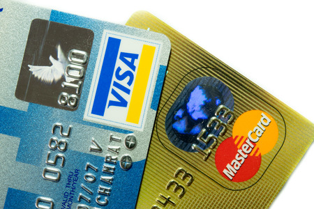 Chonburi, Thailand - August 23, 2014 : Close Up old and new Logo on Credit Cards issued by the VISA and Master Card