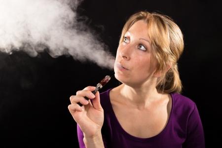 e cigarette: Woman enjoying e-cig