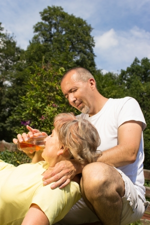 sunstroke: First aid to a eldery woman Stock Photo
