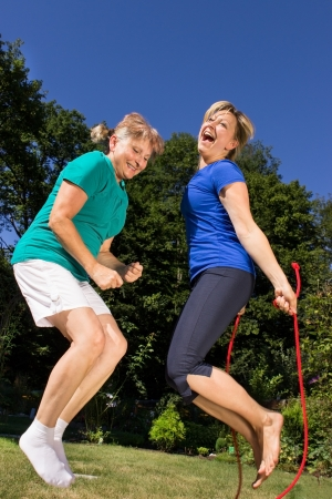 skipping rope: Women skipping a rope Stock Photo
