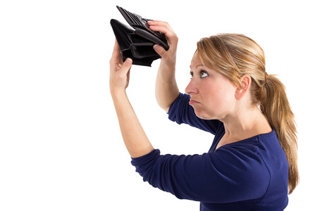 wallet: Woman looking sad at an empty wallet Stock Photo