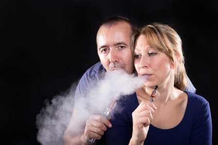 Couple enjoying e-cigarette