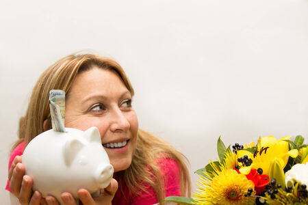 Female holding piggy bank in her hands photo