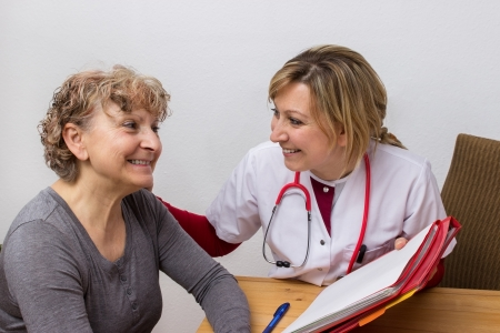 nursing record: Doctor giving some medical advice Stock Photo