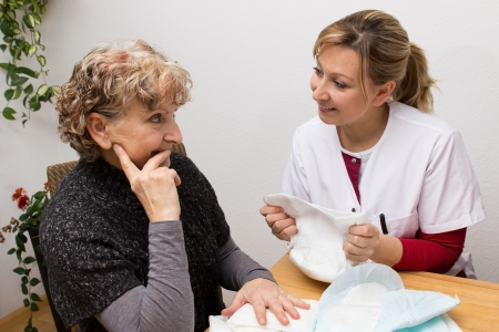 incontinence: Nurse giving an retiree some advice Stock Photo