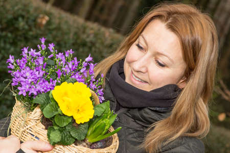heralds: Attractive female holding a basket with flowers