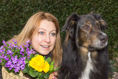 heralds: Female with flower basket and dog looking at something