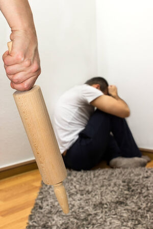 spousal: Woman treats a man with a rolling pin Stock Photo
