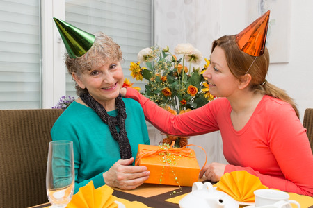 cordially: Daughter giving her mother a present
