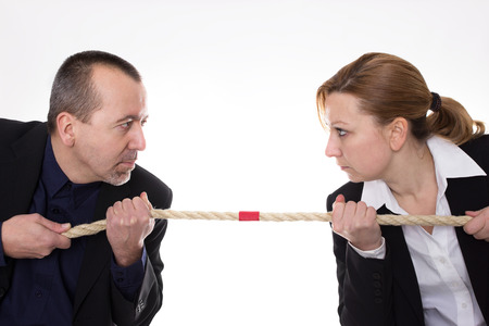 Man and woman pulling a rope against each other photo