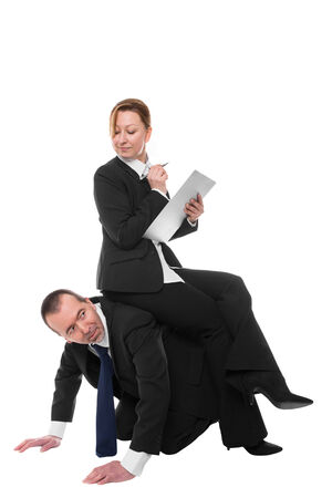 kneeling man: Woman sits confidently on a man