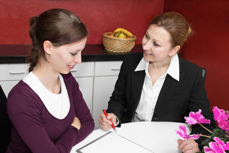 customer service representative: Customer service representative talking to a young woman Stock Photo