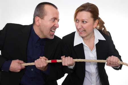 challenging sex: Businessman and businesswoman fighting with a rope